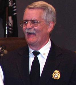 Assistant Chief Christopher Alland laughing