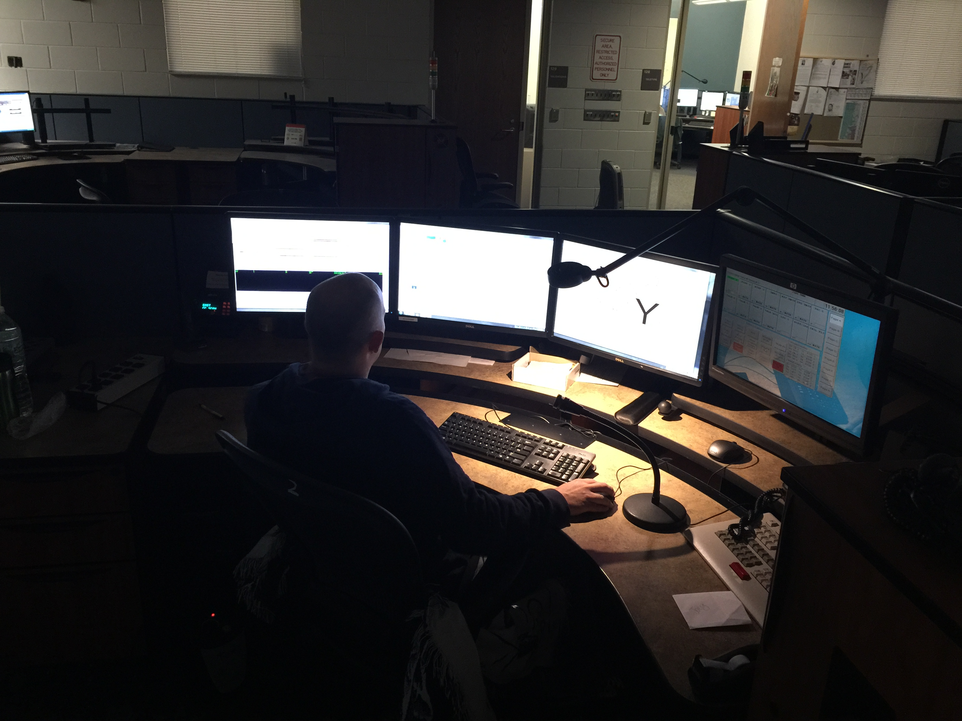 Photo of Worker at Workstation in the 9-1-1 Center