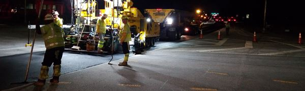 Road paving in the evening Opens in new window