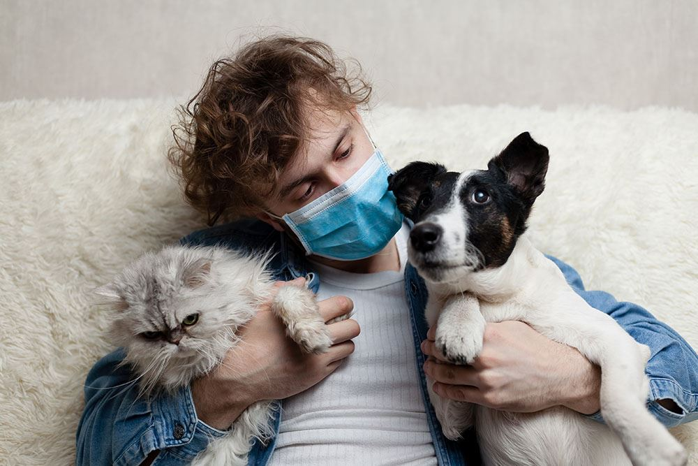 man in mask with pets