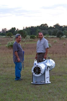Two guys setting up telescope Web