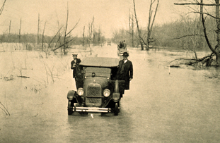 Photo of car in flooded street 1927 Courtesy of NOAA